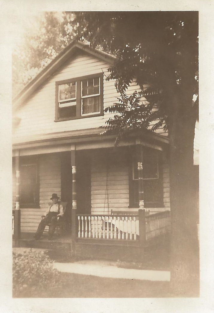First house built in McLean, photo taken in 1937. Location, original owners, and date it was built are unknown. Shown may be Rev. C. R. Barr, who served the Church of God 1935–1951 and lived there as of 1955, or P. O. Cowan, who resided there previously.