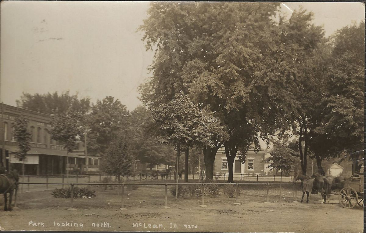 Village Square and Park, circa 1908. Still standing today are the building on the left, erected early 1880s; the house partially visible behind and to the right of it, built in 1869 by C. C. Aldrich; and the bank building (center/right), erected in 1907.