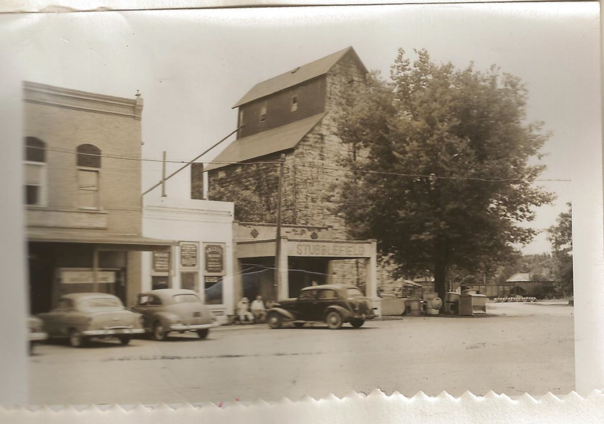 Village Square, Park St., looking southwest, circa 1955. Visible, left to right, are the McLean Bargain House, Dalziel Insurance Agency (white building), and the Ben H. Stubblefield Elevator and Mill.