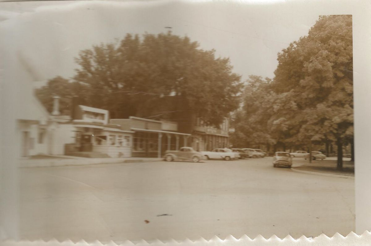 Village Square, Hamilton St., 1955. Moving north from the Fiesta Theater, most likely at this time is Howard McLane's electric shop, O. W. Earl Hardware; in brick buildings: McLean Recreation Hall, Wayne Crutchley Heating & Plumbing, and Holohan's Drugs.