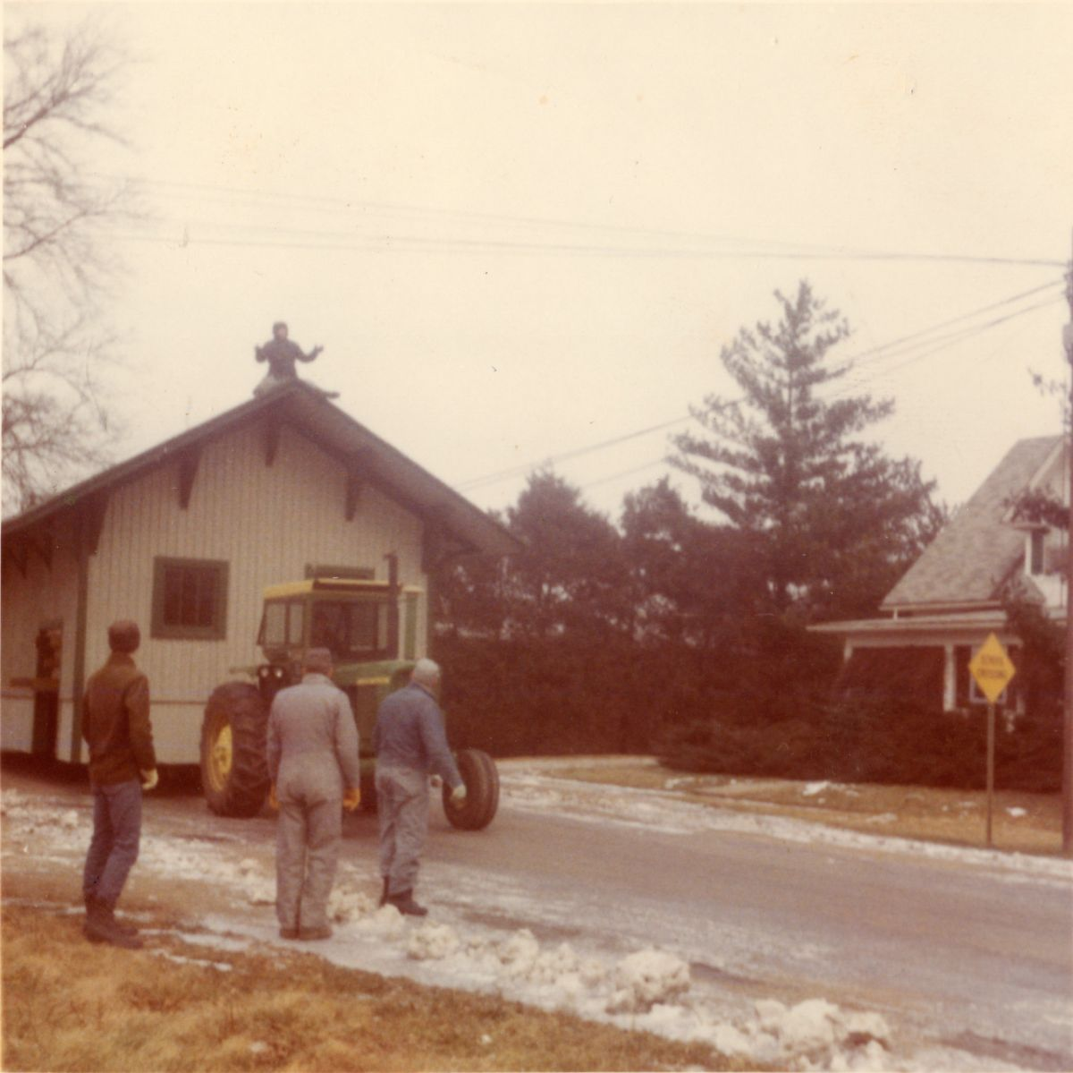 Moving the McLean Depot to its current location across from the Dixie on Hwy 136, 1971. Here it once housed antique stores and now boasts a Train Shop, where owner Tom Ludlam shares this piece of McLean history with travelers from all over the world.