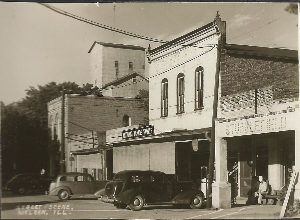 Village Square; Park St., circa 1950. Exact date of photo unknown, but appears to be previous to the establishment of Steward's Cafe (1952) and McLean Bargain House (1954). Entrance to the Ben H. Stubblefield Elevator and Mill is visible on the right.