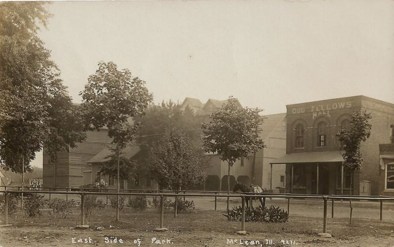 "Village Square and Park, circa 1908. The large buildings in the center of the photo are the C. C. Aldrich Elevator and Mt. Hope Mills, built in 1868 and burned down in 1915. The brick building marked ""Odd Fellows Hall"" (right) still stands there today."